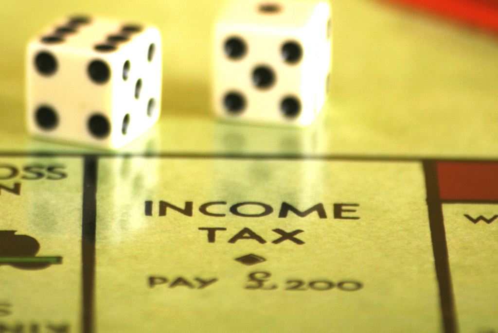 Income Tax square on Monopoly board, with dice. Picture by Alan Cleaver.