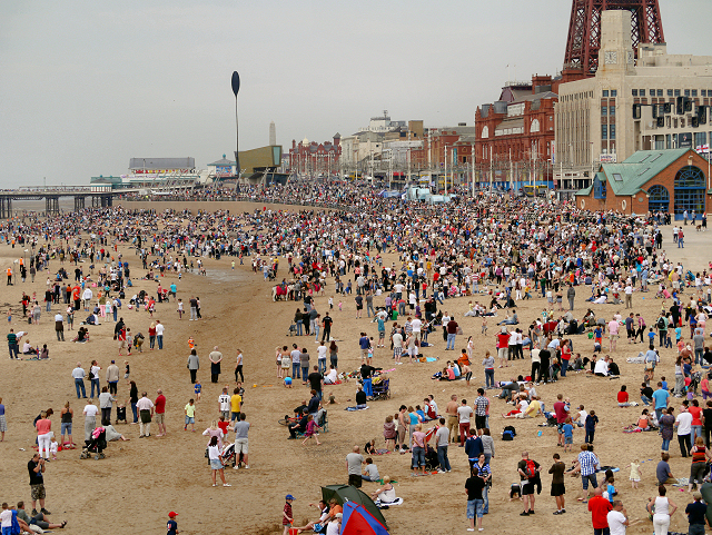 holiday crowds on a beach in summer