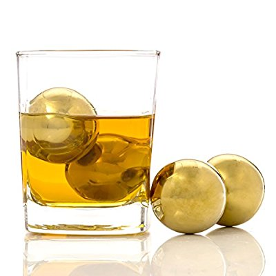 a drink with golden ice cubes