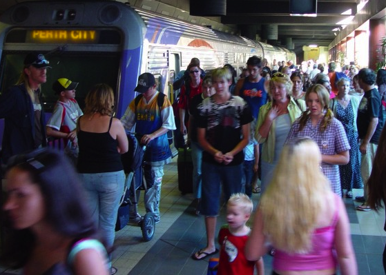 crowd of commuters at a railway station