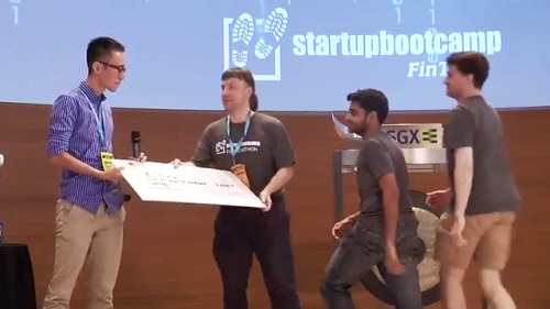 young men pitching to a startup bootcamp